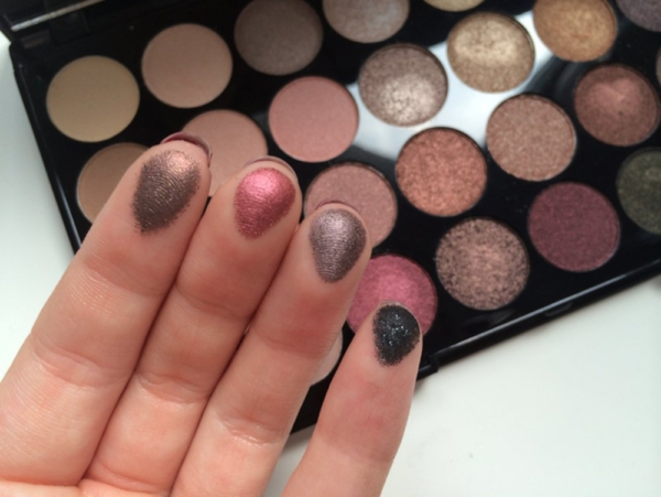 Makeup Revolution Ultra 32 Shade Eyeshadow Palette hand
